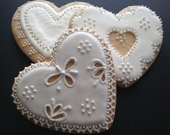 Valentine cookies | pure white heart cookies | Custom decorated cookies | embroidered lace like pattern | white lace hearts