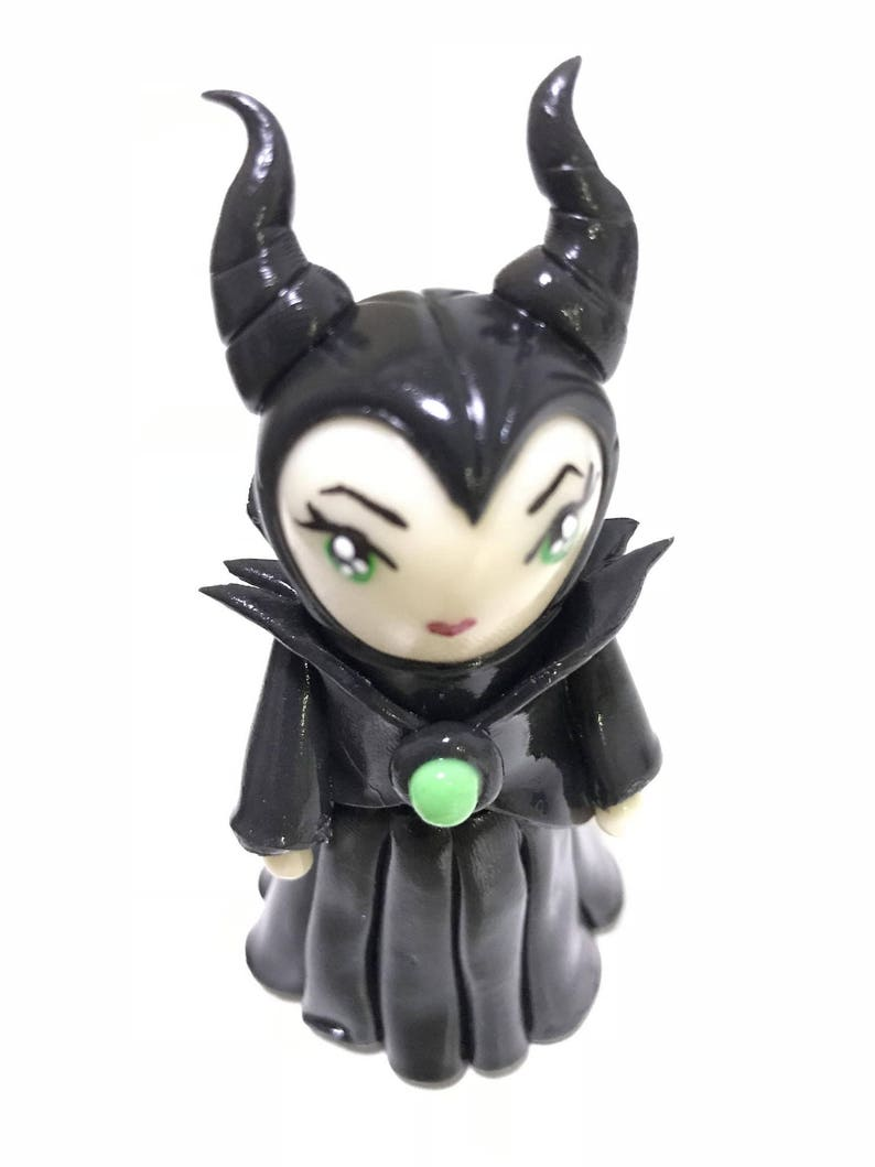 Malificent-Doll-with-Traditional-Thai-Herbal-Borneol-Herb-Water-Pim-Saen-Water