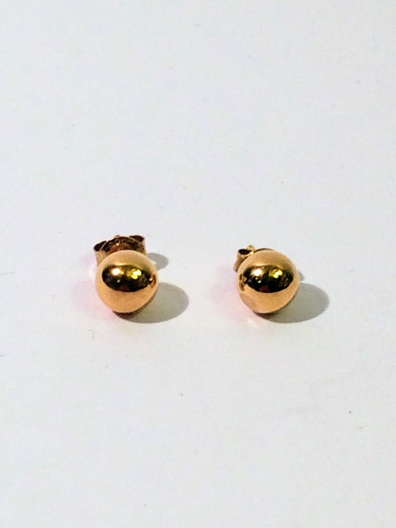 375 gold 9K gold earrings Laura Lee  9K gold hoop earrings with Rubies
