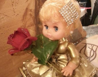 "OOAK ""Oldie Goldie"" Vintage baby doll re-fashioned and decorated. Comes with rose prop."