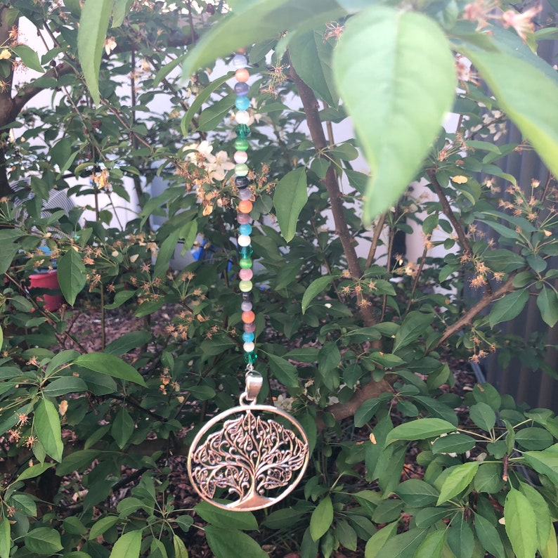 beaded wooden tree of life silver tree of life silver heart with silver tassels silver cross. Suncatchers