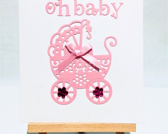 Baby card, baby girl, new baby, welcome baby, pink, pink pram pushchair, message inside, girl baby.