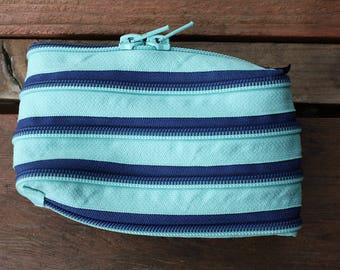 light blue and dark blue horizontal zip pouch