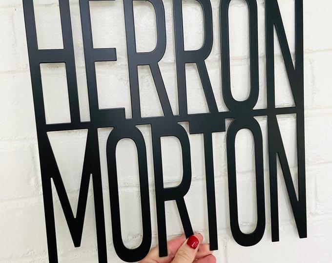Herron Morton Sign
