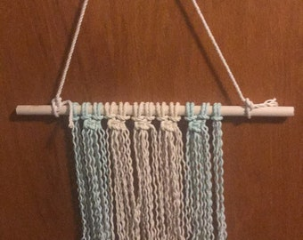 Turquoise and cream macrame wall hanging