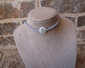 gray choker with a white pearl with a clasp