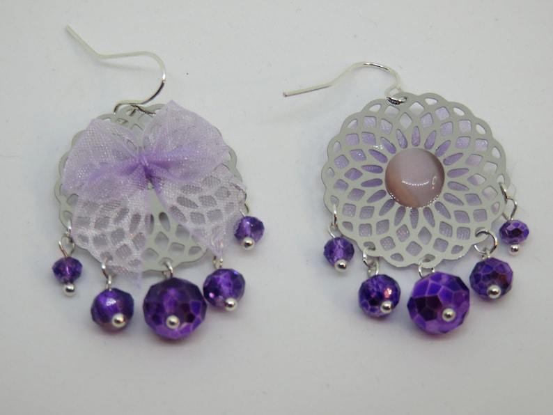 NYLIA silver print with faceted beads and a purple bow