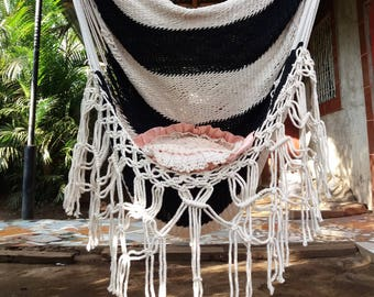 White and black  hammock chair with knots