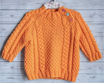 knitted little handmade sweater for baby orange color