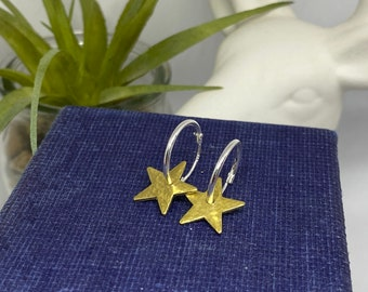 Hammered brass stars on sterling silver hoops