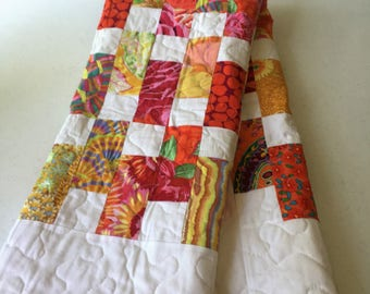 Baby quilt, crib quilt, beautiful and bright kaffe fassett fabrics, reds, oranges, pinks, yellows, great gift for welcoming a new child