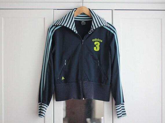 Adidas Joggingjacke hellblau glänzend mit weißen Streifen