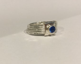 Silver hammered ring with topaz ice blue