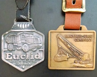 Pair of Vintage Metal Watch FOBs -  EUCLID  &  BUCYRUS-ERIE Co
