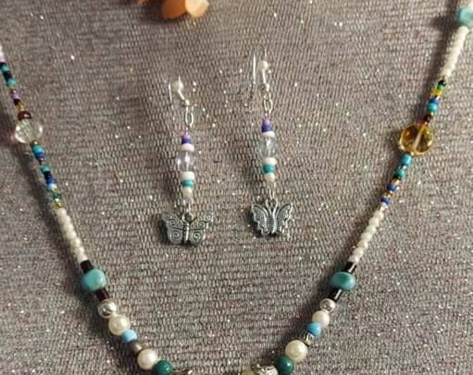 Necklace and earring butterflies and hearts boho vintage bits and pieces transformed into wearable art designs Artist Heather Hutcheson