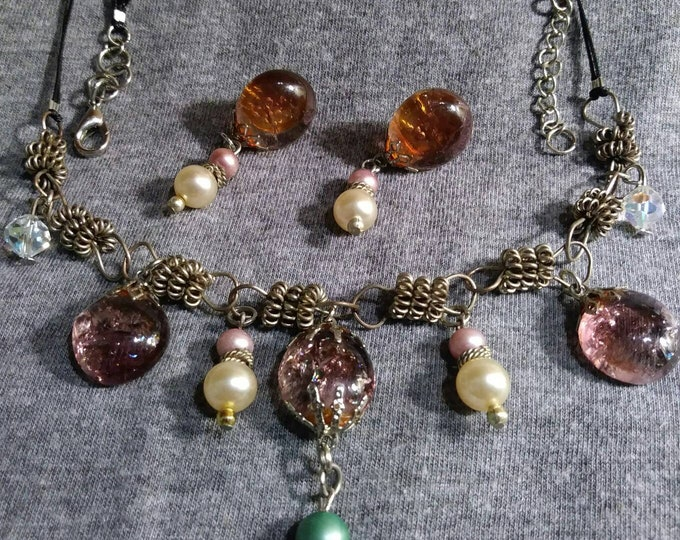 Vintage necklace.  One of a kind. Transformed from bits and pieces of vintage jewelry into wearable art design artist Heather Hutcheson