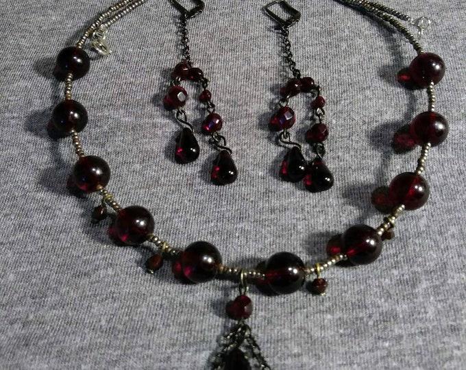 Vintage glass garnet beads transformed into  wearable art. Earrings 30s Artist Heather Hutcheson, Mixed Vintageables. Edwardian Shadows.
