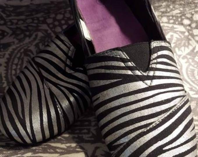 Metallic silver and black slip on flats tiger or zebra animal print