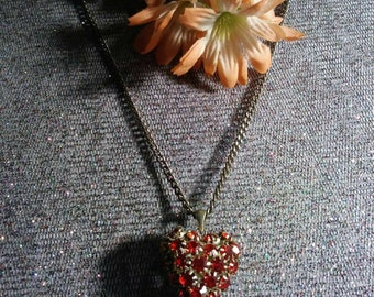 Ruby red jewelry puffed heart pendent on silver tone chain 70s