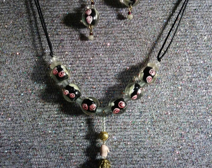Lampwork glass bead jewelry. One of a kind redesigned into wearable art by Artist Heather Hutcheson.