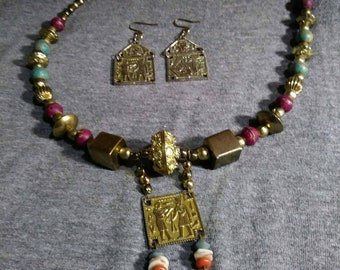 Egyptian theme. Brass painted beads vintage metal pressed earrings. One of a kind handmade by Artist Heather Hutcheson.