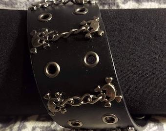 Leather cuff bracelet punk rock or biker bracelet with skulls 90s.