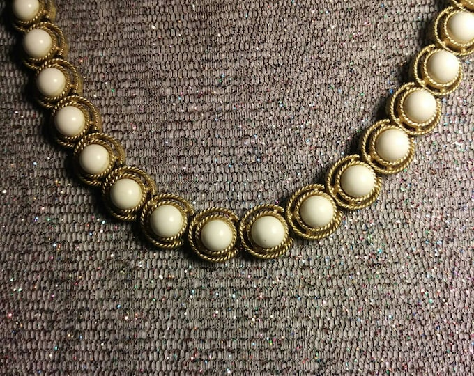 Choker style necklace white beads on gold tone setting 1970s