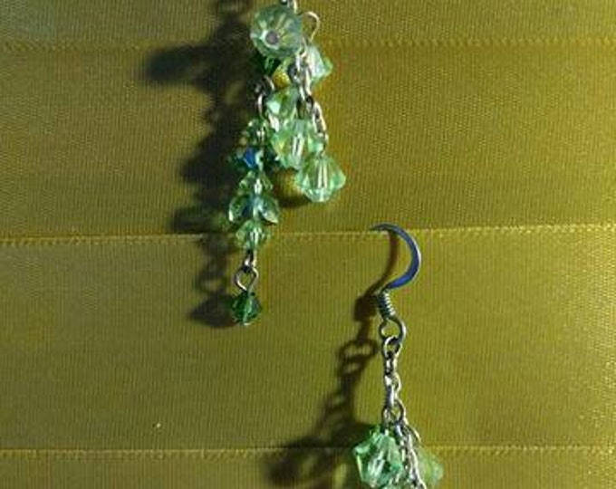 Earrings vintage 20s style. Bits and pieces of vintage jewelry transformed into wearable art.  Artist Heather Hutcheson  Light mint air.