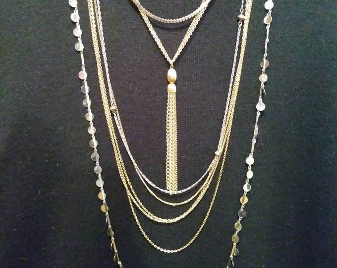 Layered or stackable necklaces silver and gold tone chains from the 70s.