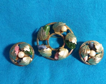 Sarah Coventry brooch and clip on earrings set.  Leaf design with coloured stones.60s