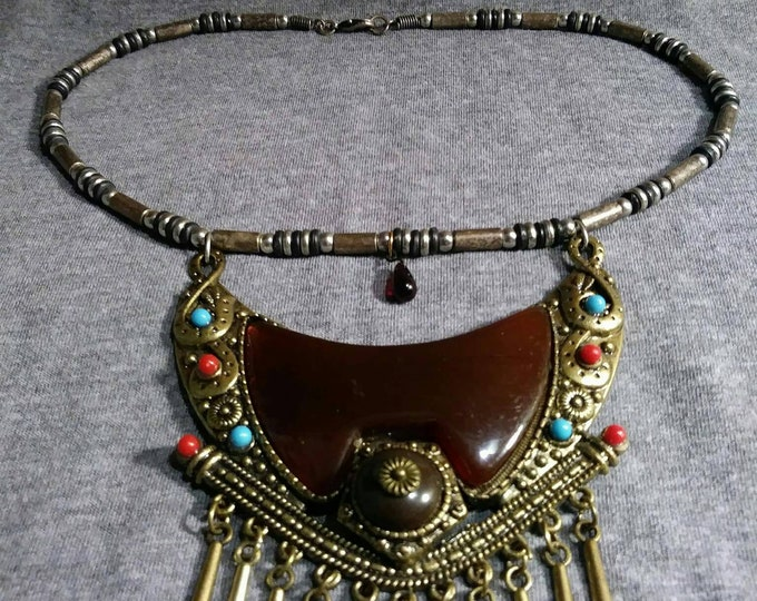 Vintage amulet necklace.  Redesigned, refurbished bits and pieces of vintage jewelry.  By Artist Heather Hutcheson