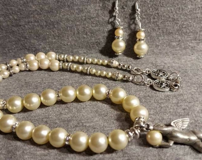 Angel and pearl jewelry original one of a kind with a JJ jewelry pendent  mixed vintageables design Heather Hutcheson