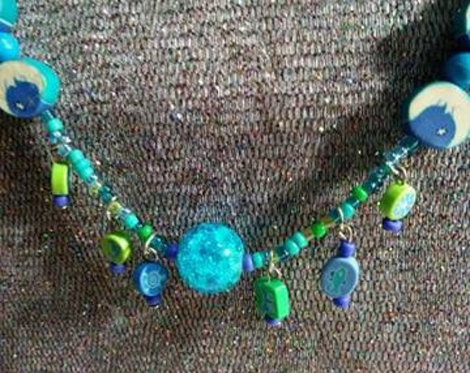 Moon jewelry vintage bits and pieces transformed into wearable art Mixed Vintageables Celestial Joy by Artist Heather Hutcheson