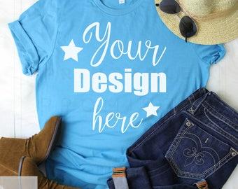 Download Free Bella Canvas 3001 Aqua T-shirt Mockup-T-Shirt Mockup-Mock Up-Flat Lay-Outfit Wood Background-Flat Lay Mockup PSD Template