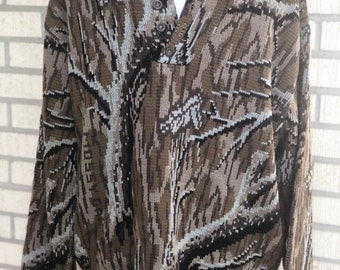 adbb39f6b2965 Vintage mossy oak camouflage hunting sweater by whitewater outdoors company.