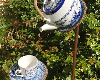 Japanese tea pot birdfeeder with wicker handle and matching cup/saucer