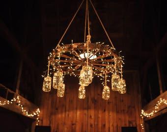 Wagon wheel chandelier etsy wagon wheel chandelier mozeypictures Choice Image