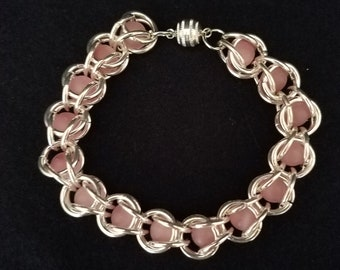 Metal Bracelet with pink beads and magnetic closure