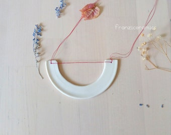 Porcelain white pendant/jewel made by hand/nacklace porcelain. Porcelain and franziceramics red wire necklace