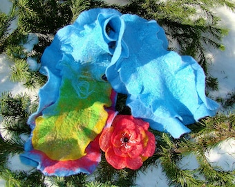 Scarf with two rows of ruffles and a flower brooch.