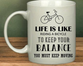 Life Is Like Riding A Bicycle To Keep Your Balance, You Must Keep Moving | Mug | Quote