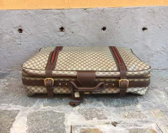 e4af1b0493c Gucci case in vintage beige monogram fabric with leather inserts.