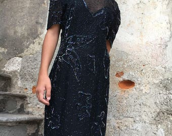 Black sheath dress with multicolor beaded embroidery.