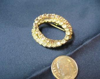 twin oval brooch