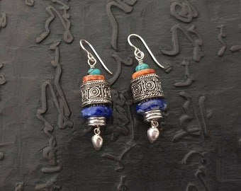 Spiny oyster shell, lapis, turquoise and sterling silver earrings.  Ear wire, lever back, post or clip on available.  Lightweight.
