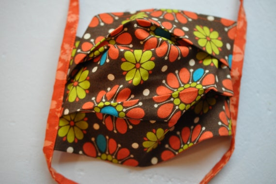 Flowers on Brown Fabric and Orange Foliage Mask