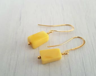 Honey amber, rectangular, wire wrapped, gold plated earrings.