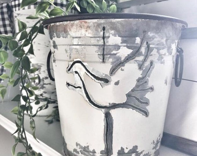 Cross and Dove Cut Bucket