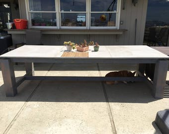 Concrete top outdoor dining table