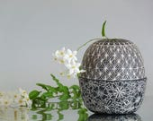 White ceramic vase with black and white sgraffito technique